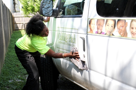 A United Methodist Women volunteer spruces up a Cabbage Patch van