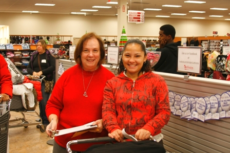 A volunteer from Harvey Browne Memorial Presbyterian Church helps a Cabbage Patch client with her Christmas shopping.